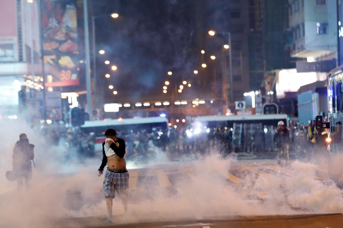 Hong Kong protesters hurl petrol bombs after police fire tear gas to clear rally