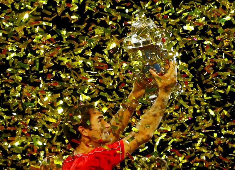 Federer brushes De Minaur aside to claim record tenth Basel title