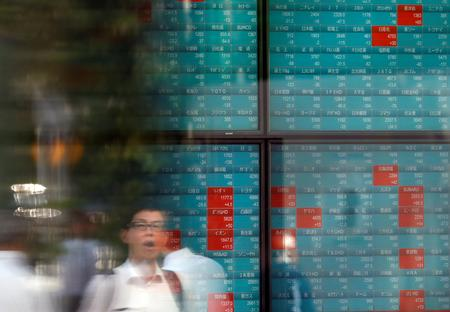 Asian shares slip before Fed decision on trade deal worries