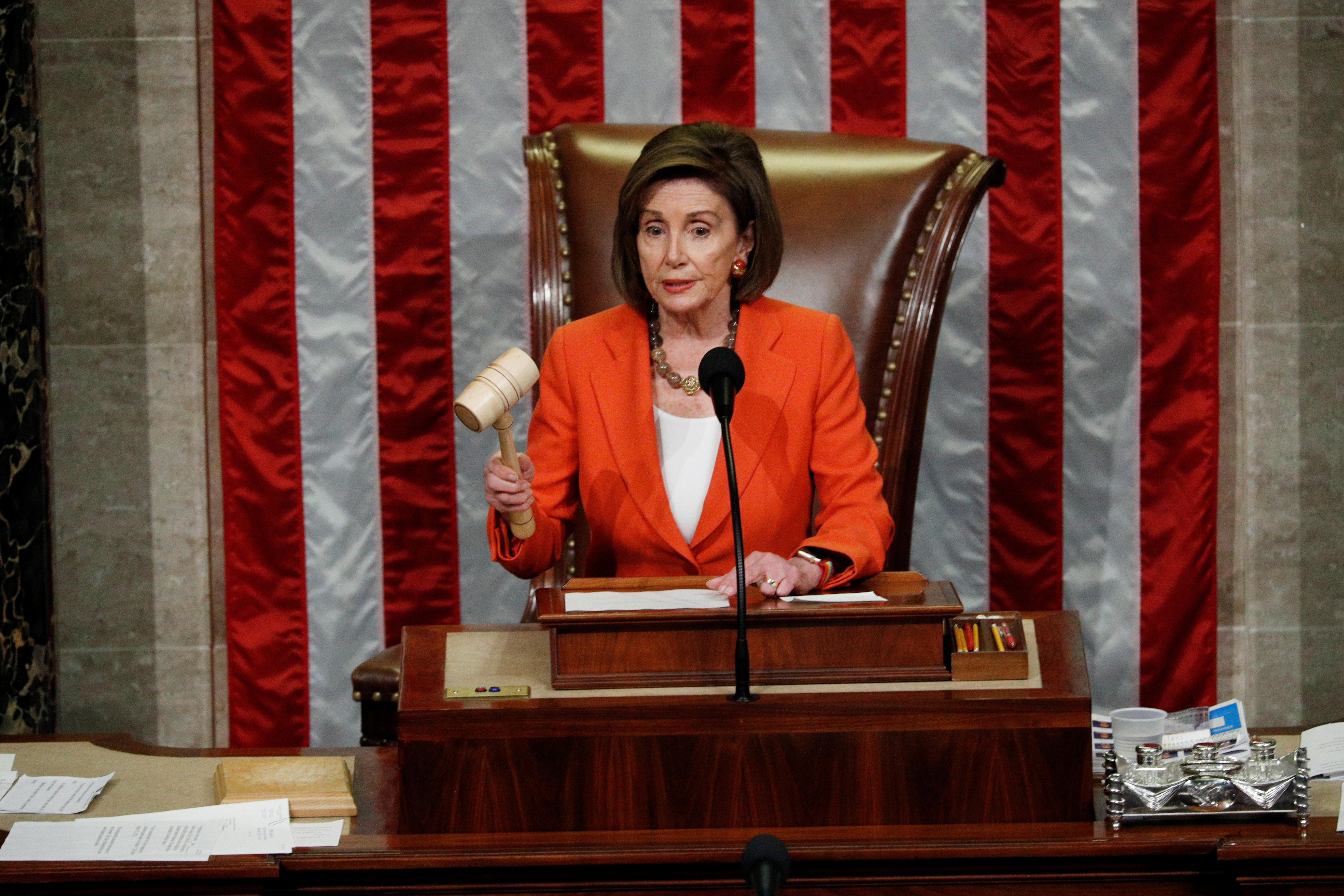 Trump impeachment effort passes first test in divided U.S. Congress