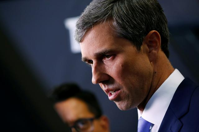 FILE PHOTO: Former Rep. Beto O'Rourke talks to reporters in the Spin Room after the fourth Democratic U.S. 2020 presidential election debate at Otterbein University  in Westerville, Ohio October 15, 2019. REUTERS/Aaron Josefczyk/File Photo