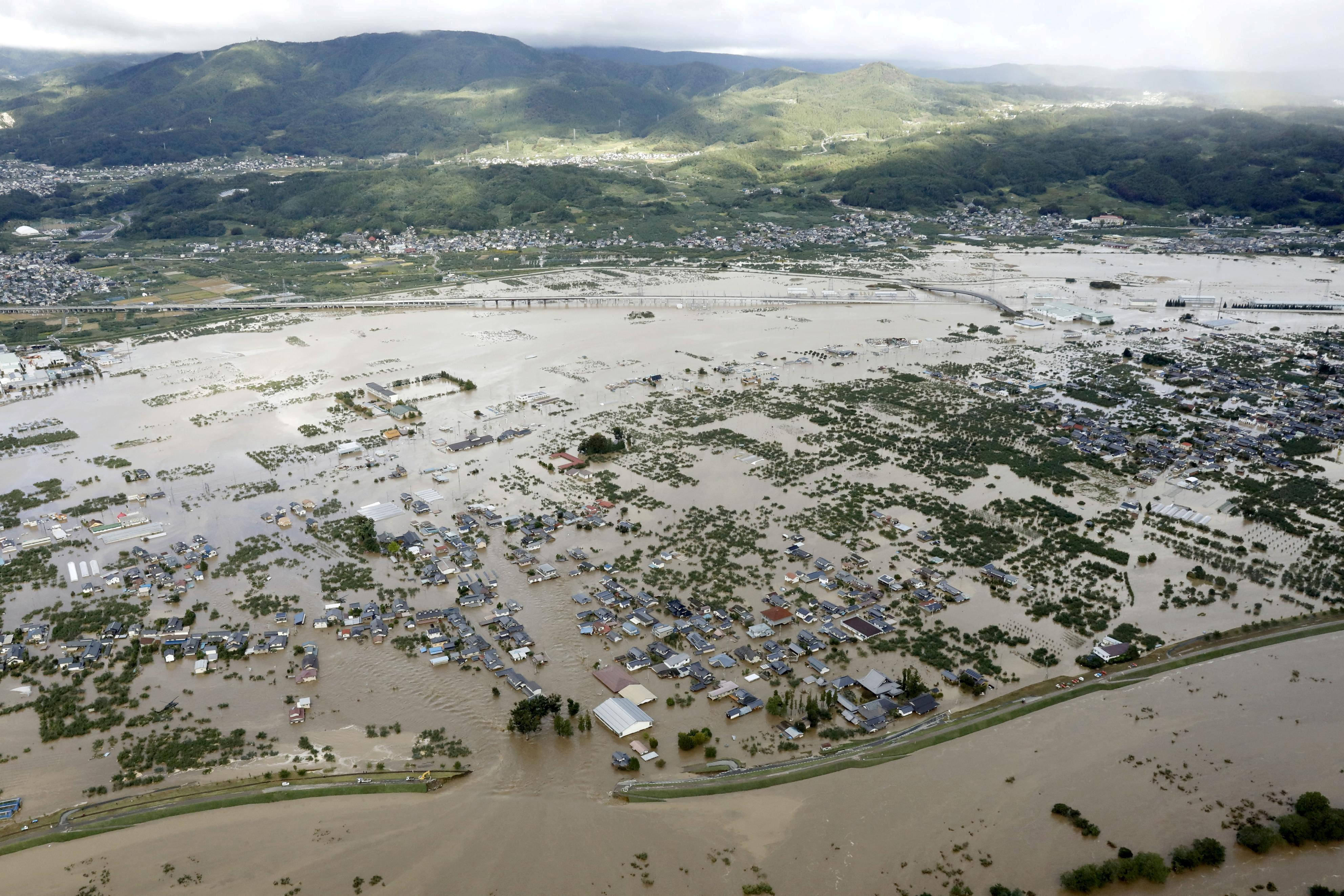 Most Japan firms affected by typhoons, want Abe govt. to spend...