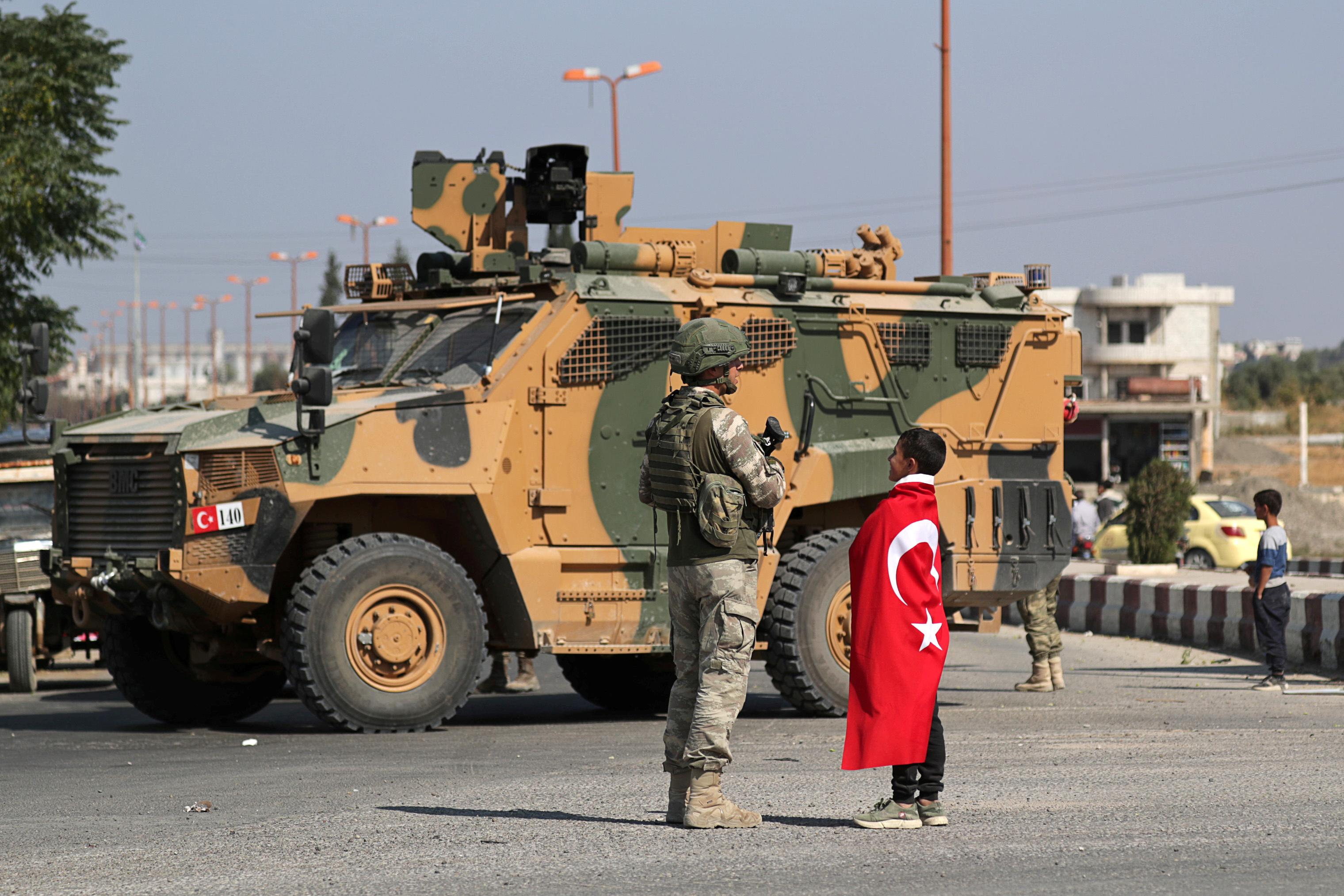 Erdogan says Turkey will not leave Syria until other countries pull...