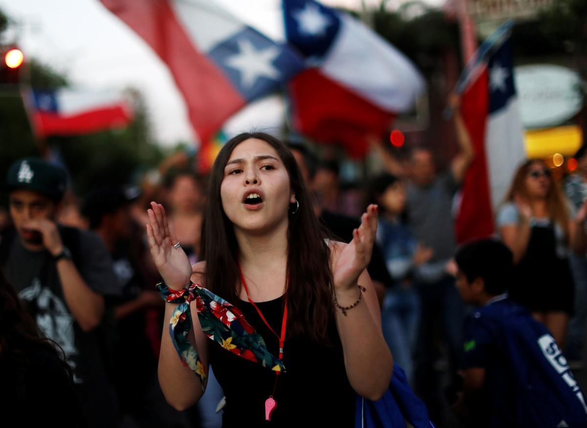 Chile to re-write Pinochet-era constitution in win for protesters