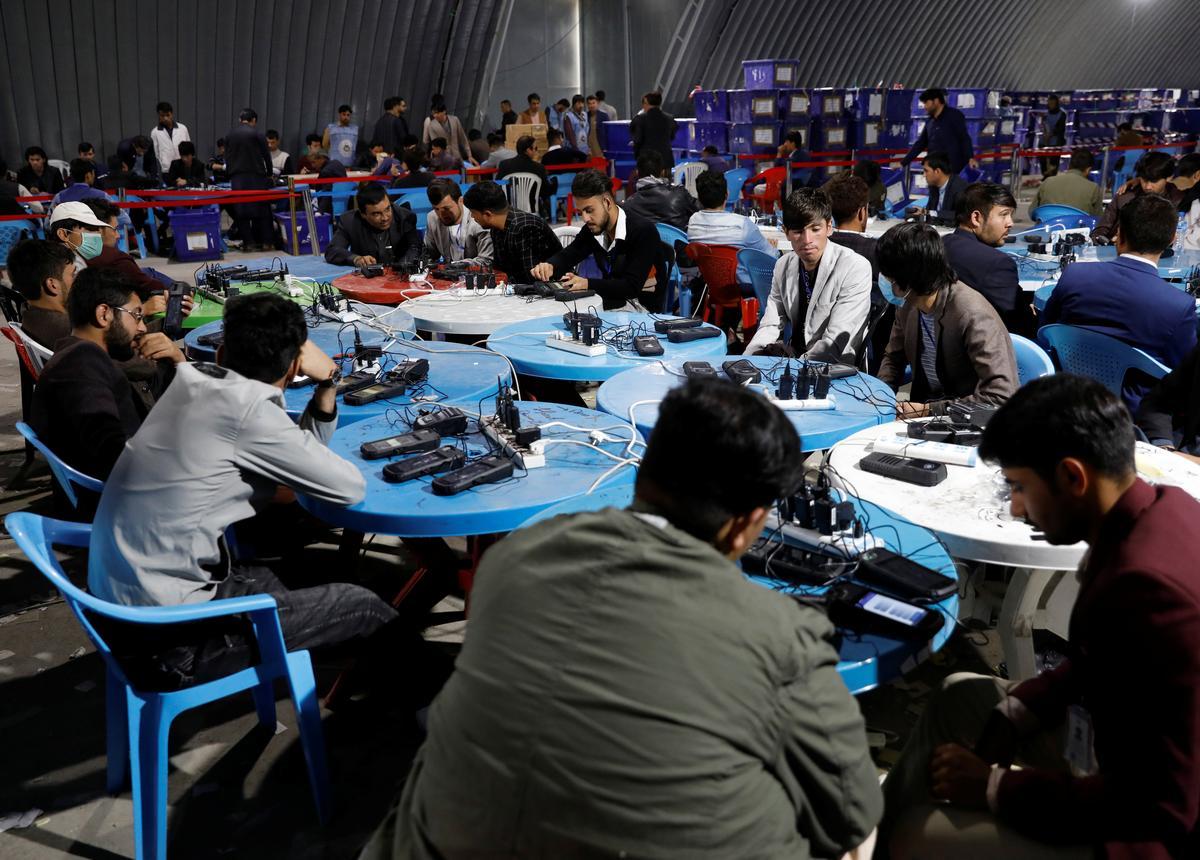 Result of Afghan presidential vote postponed again: election...