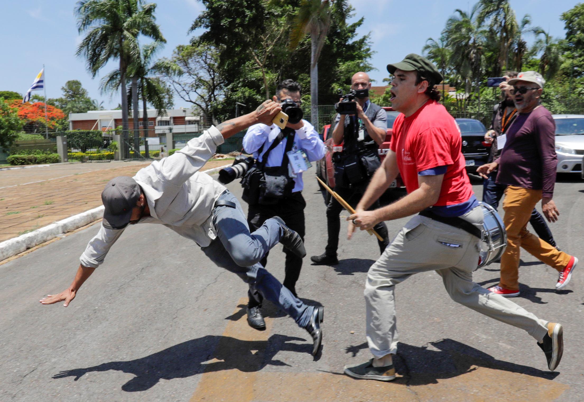 Brazil's Bolsonaro vows order after Guaido backers enter Venezuelan...
