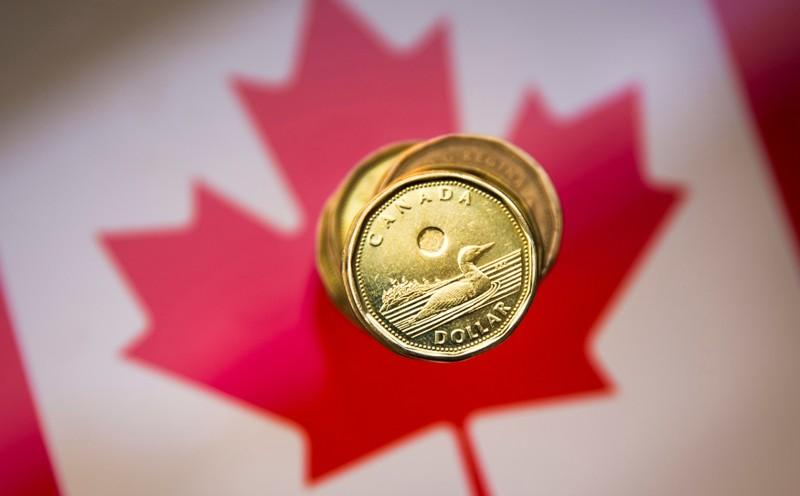 Canadian dollar holds near one-month low ahead of Poloz speech