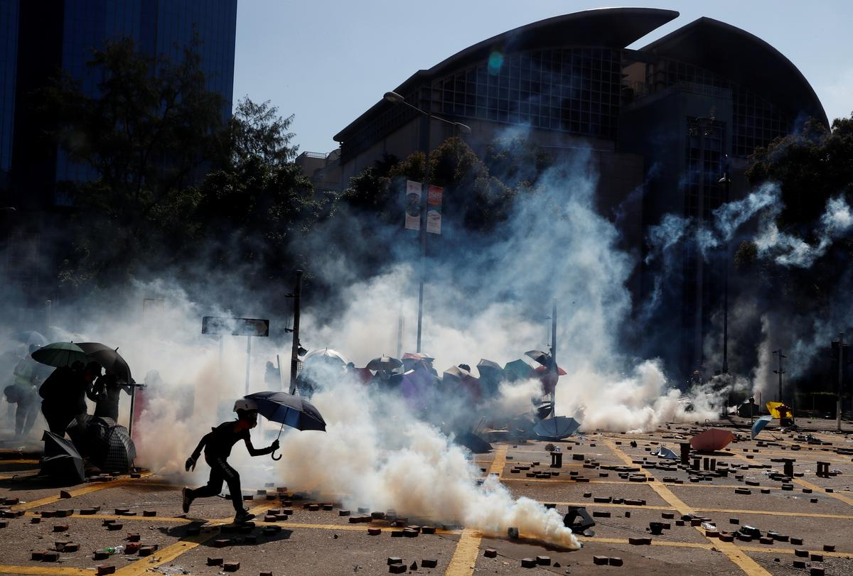 Hong Kong campus protesters fire bows and arrows, set fires