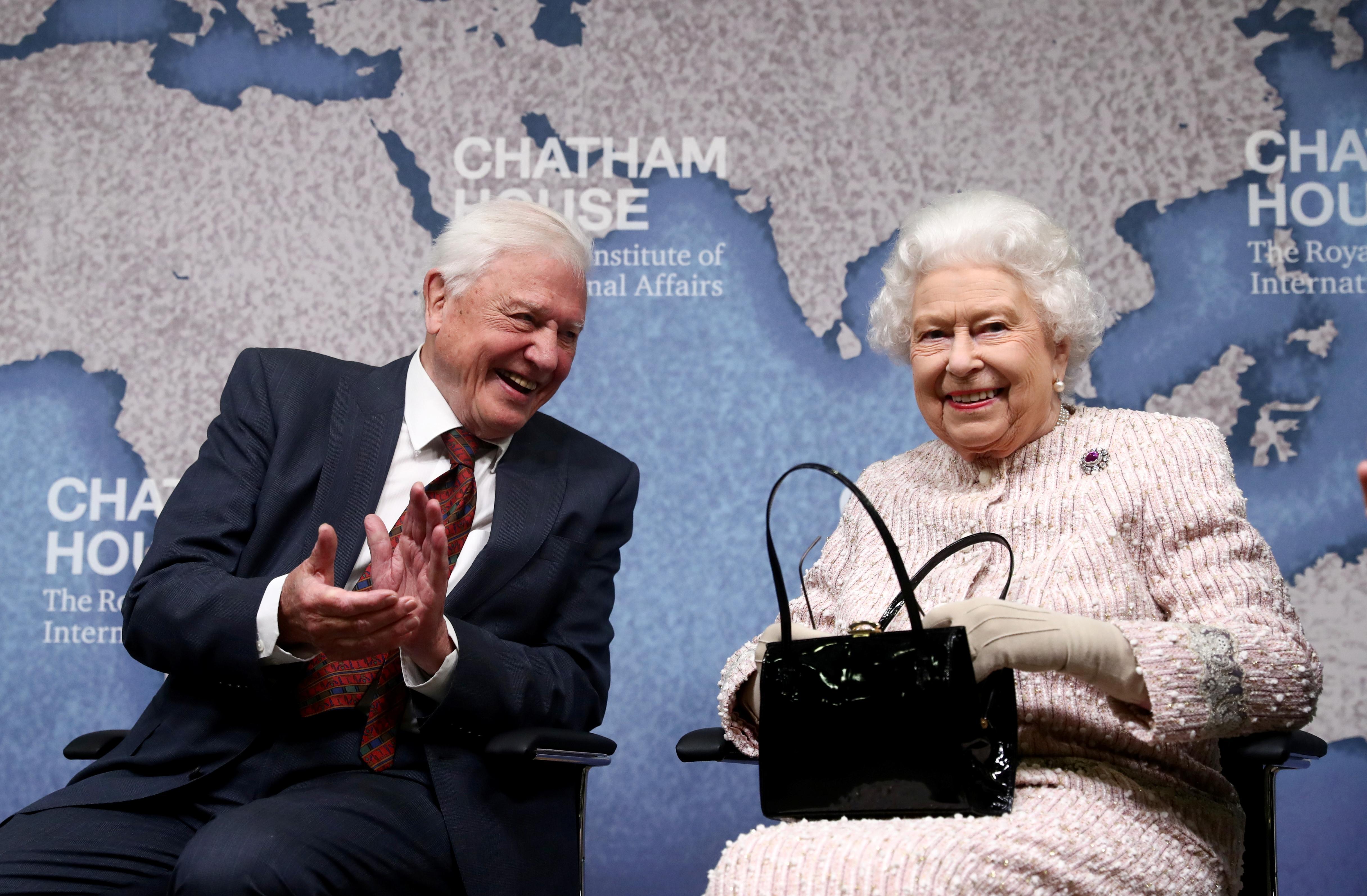 Queen Elizabeth presents naturalist Attenborough with award for...