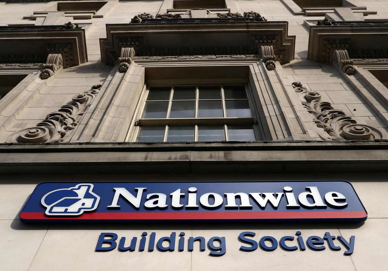 Image result for Britain's Nationwide reports profits fall 33% as spending, competition bite