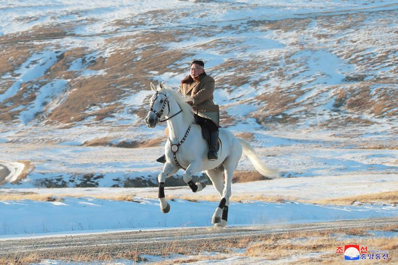 North Korean leader Kim Jong Un rides a horse during a snowfall in Mount Paektu in this image released October 16, 2019. KCNA via REUTERS