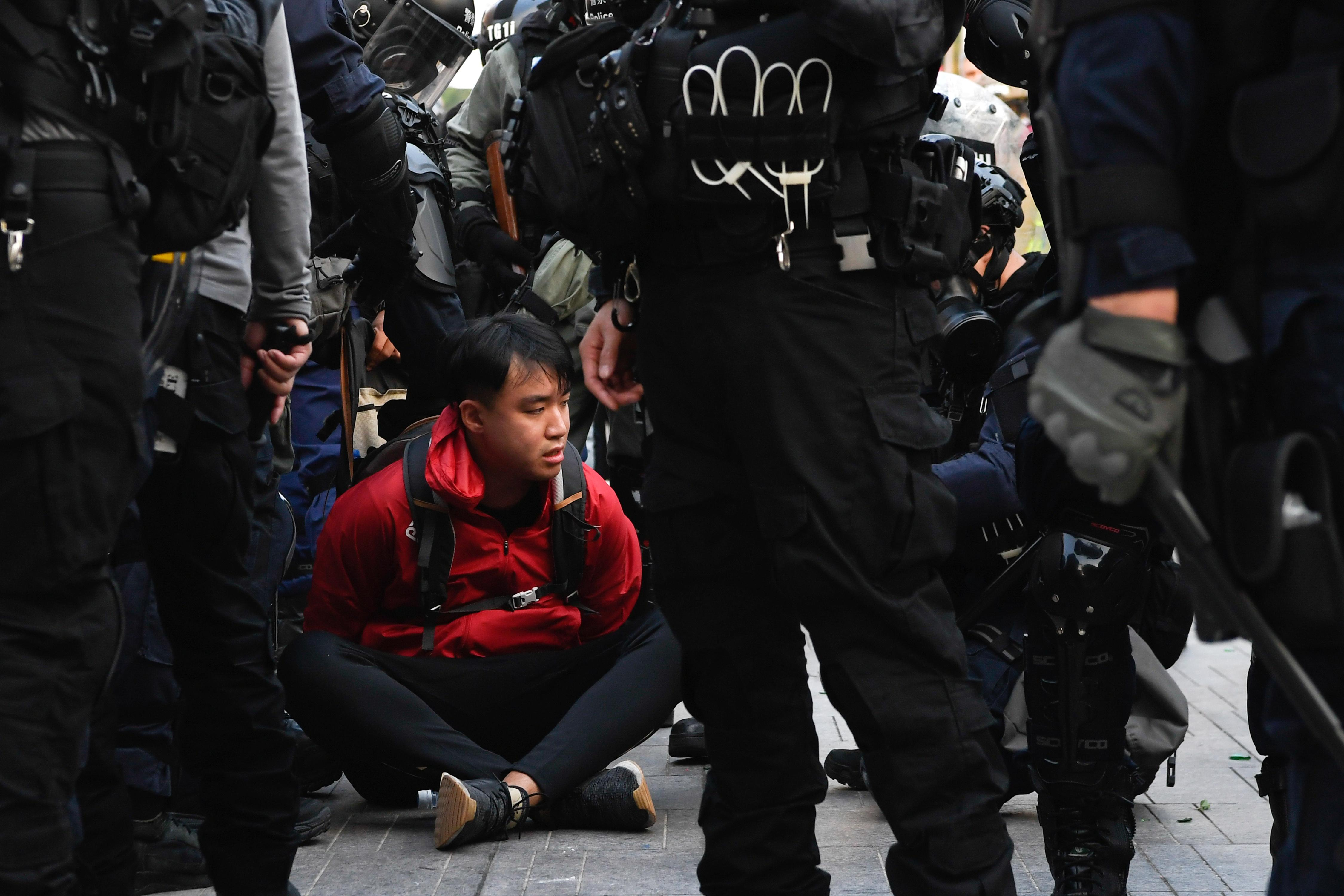 Hong Kong police fire tear gas as thousands take to the streets in...