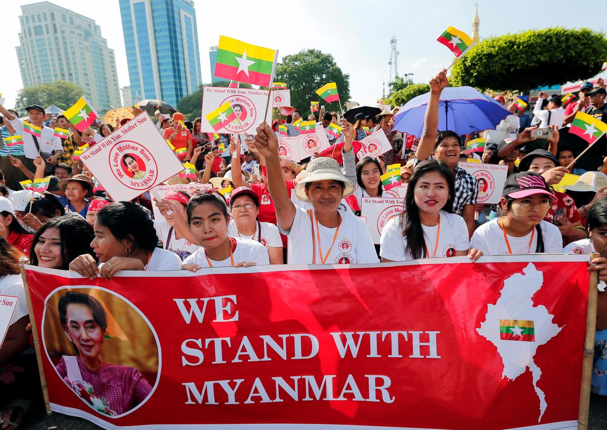 Suu Kyi's loyalists rally for Myanmar leader before genocide trial