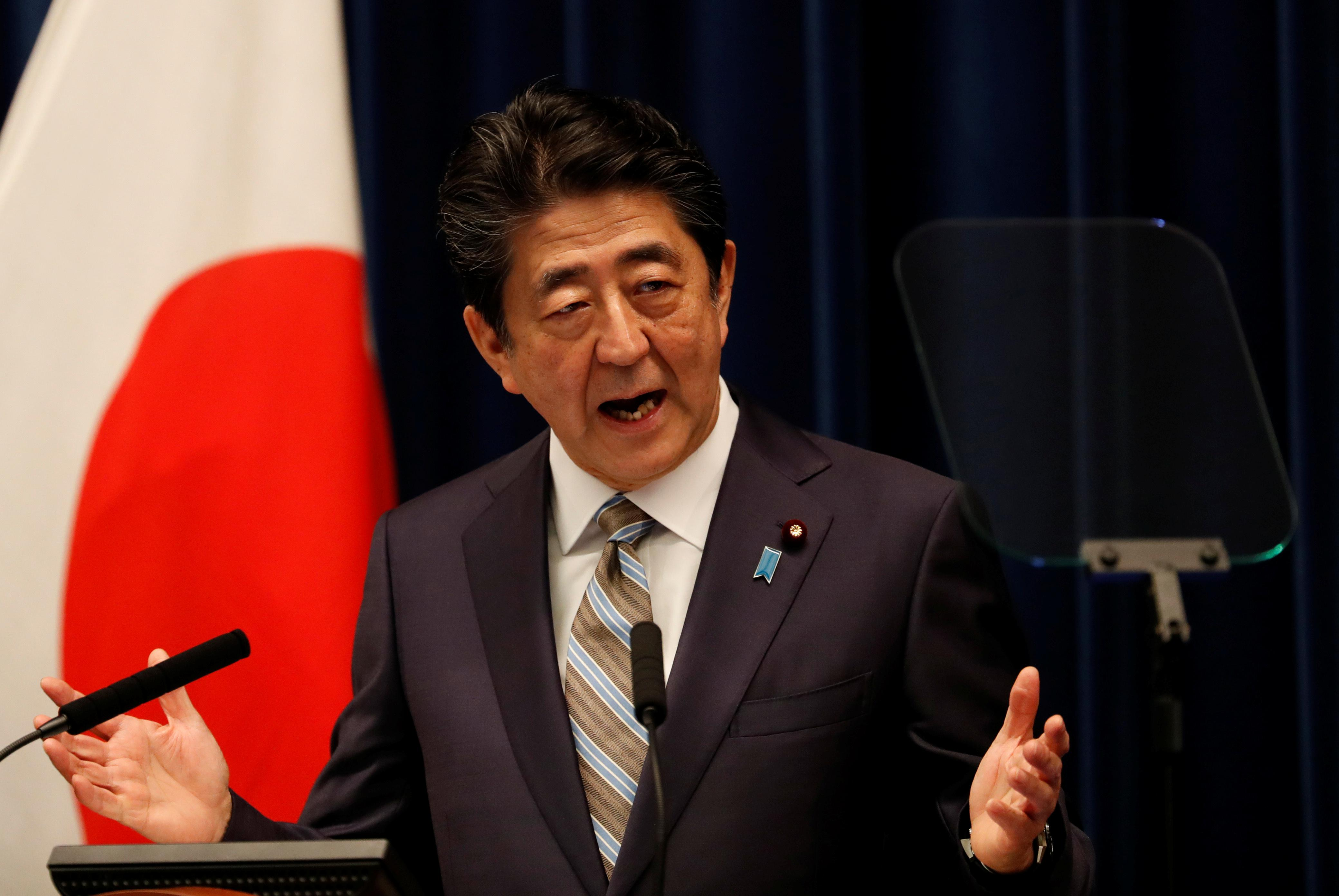Japan PM Abe says in discussions about possible Japan visit by...