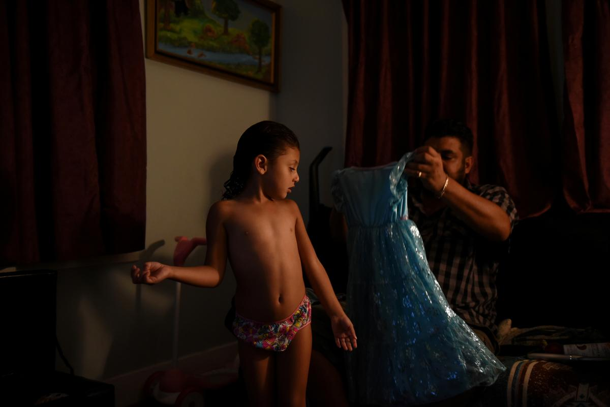 Caring alone for two small girls, Texas father grapples with loss
