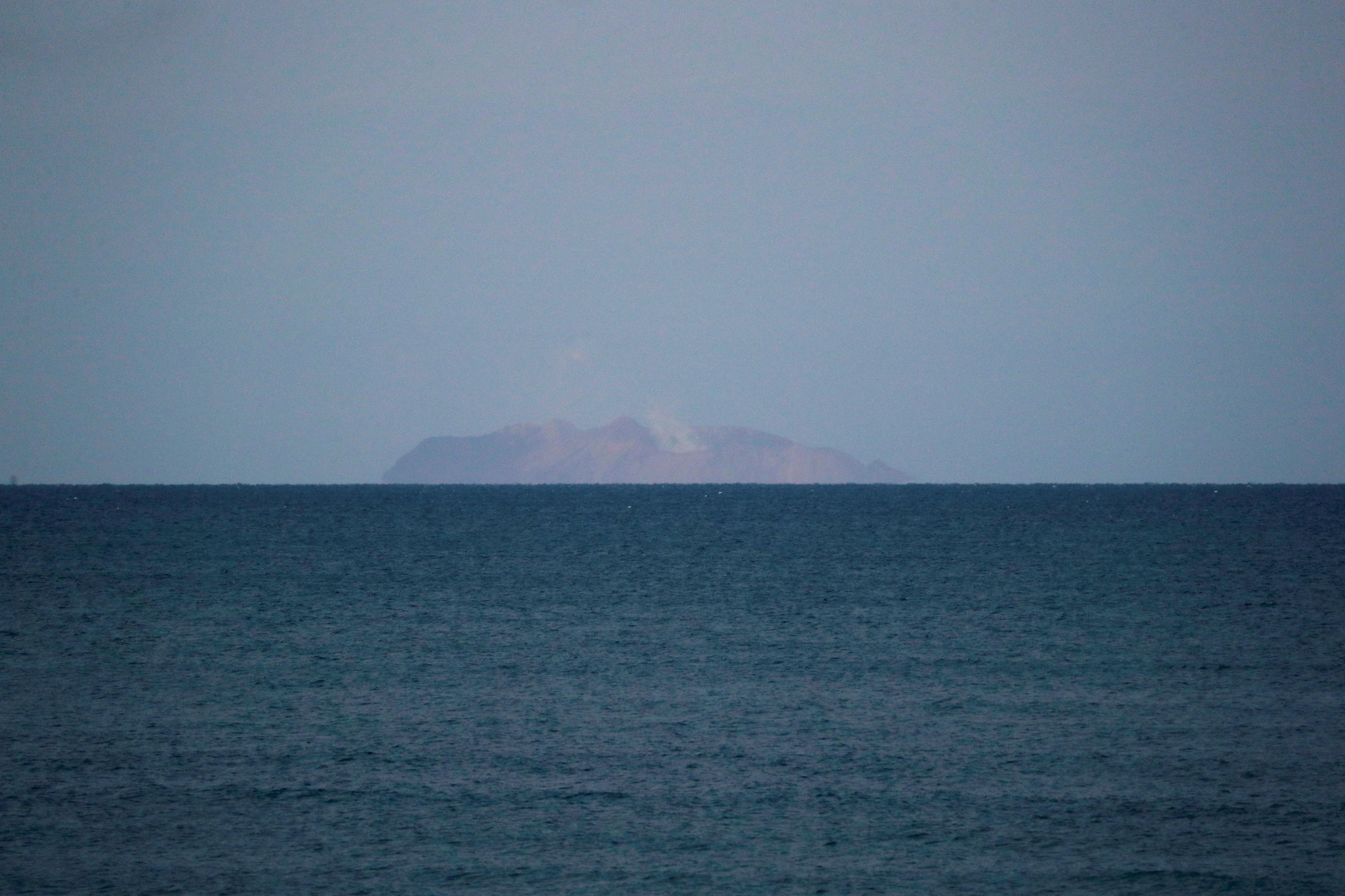 Spitting volcano keeps search parties off New Zealand island, death...