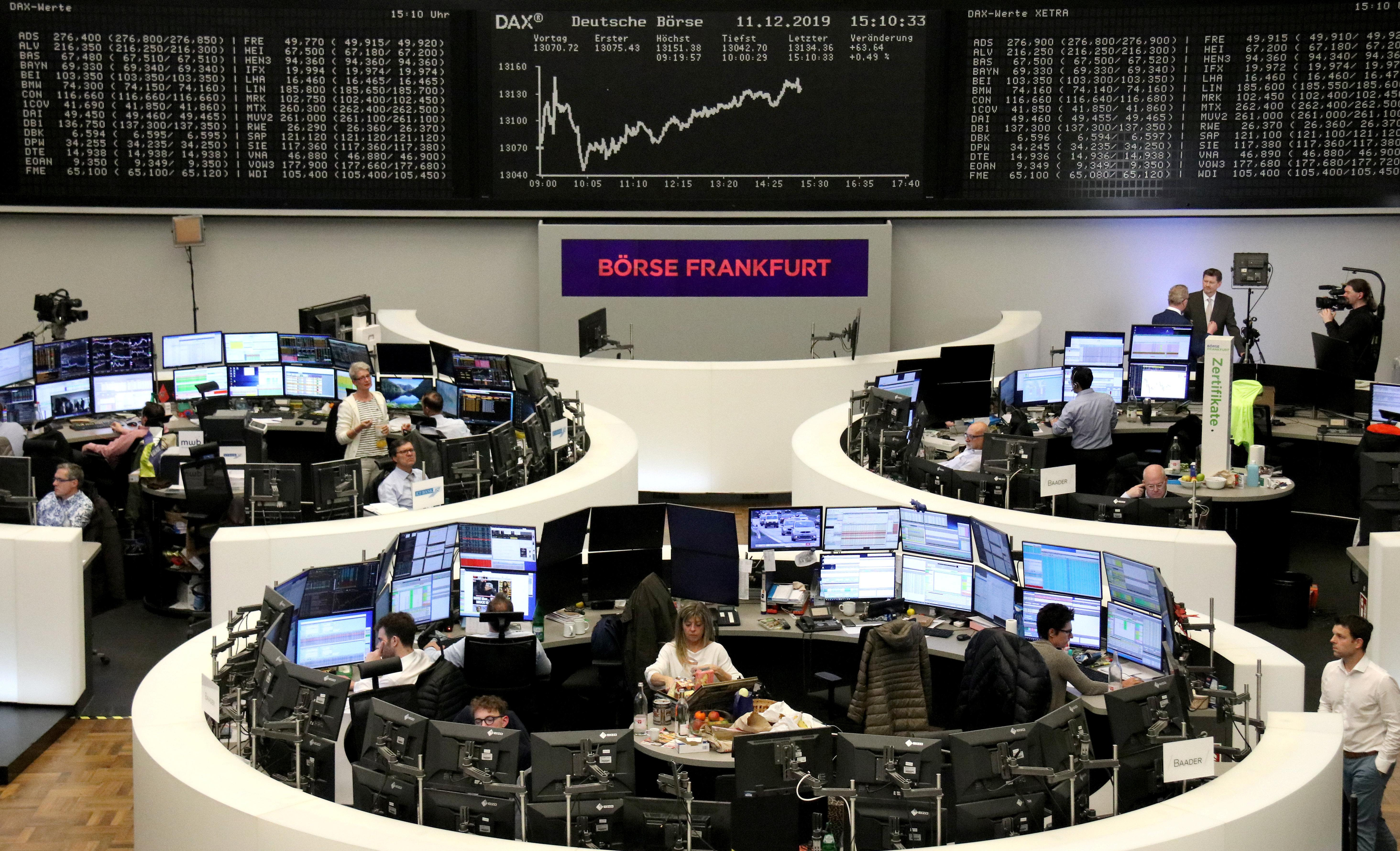 ECB, upbeat trade news push up European shares before UK election...