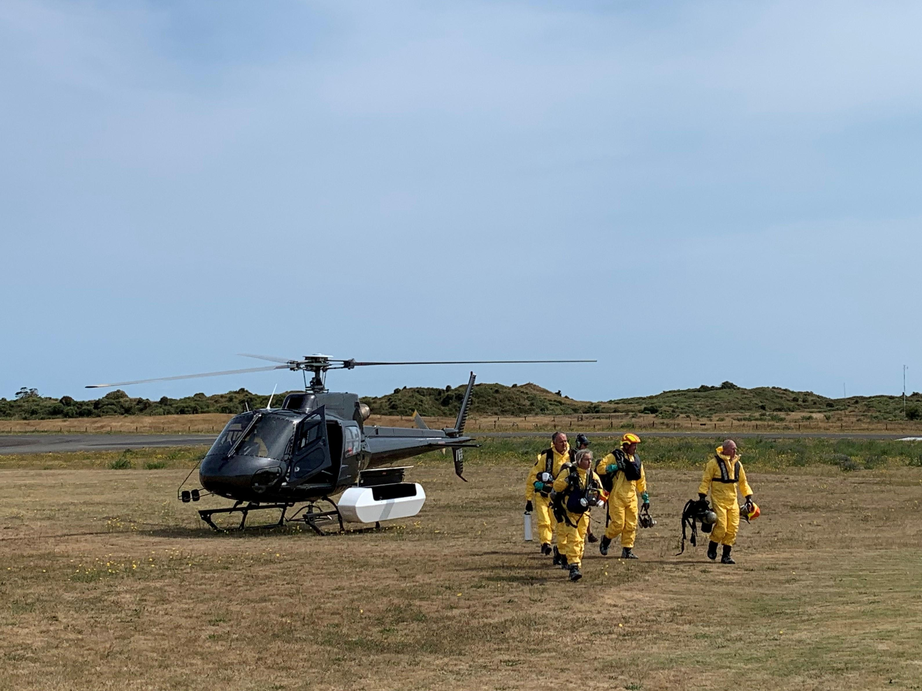 New Zealand recovery teams return to volcanic island, two remain...