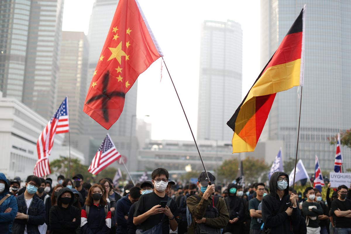 Protesters rally near Hong Kong harbour, more demos planned over Christmas