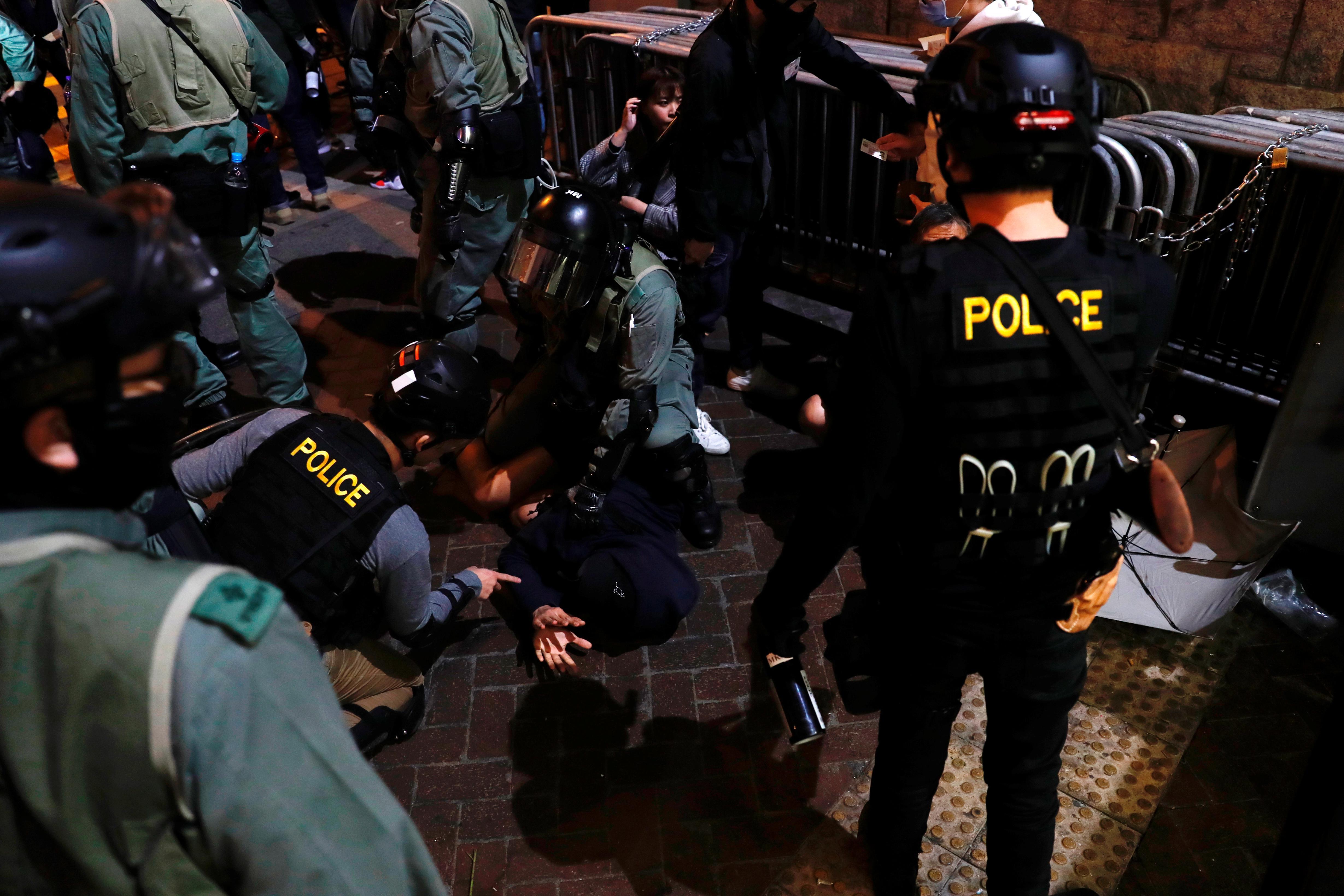 Les acclamations festives sont rares alors que les militants de Hong Kong organisent des manifestations du Nouvel An
