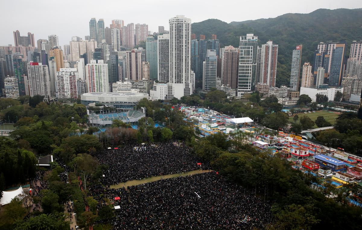 "Tear gas fired at Hong Kong new year's mass march as protesters vow to ""keep fighting"""