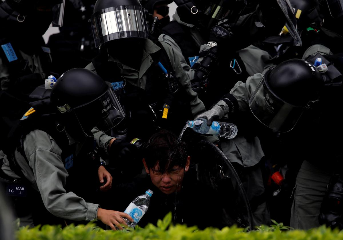 Dozens arrested after Hong Kong protest taking aim at Chinese traders