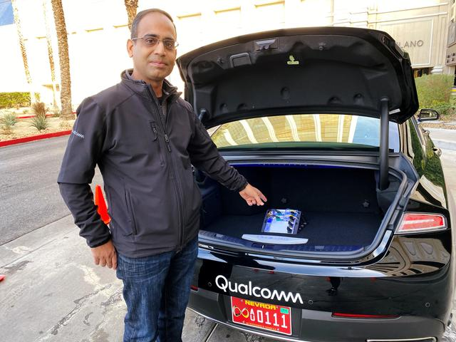 Dheeraj Ahuja, Senior Director Of Engineering at Qualcomm, shows the new Snapdragon Ride autonomous driving computing system in the trunk of a demo car at the Consumer Electronics Show (CES) in Las Vegas, U.S., January 5, 2020.  REUTERS/Jane Lanhee Lee