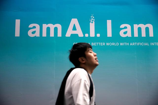 FILE PHOTO: A sign advertising AI is seen at CES (Consumer Electronics Show) Asia 2019 in Shanghai, China June 11, 2019. REUTERS/Aly Song
