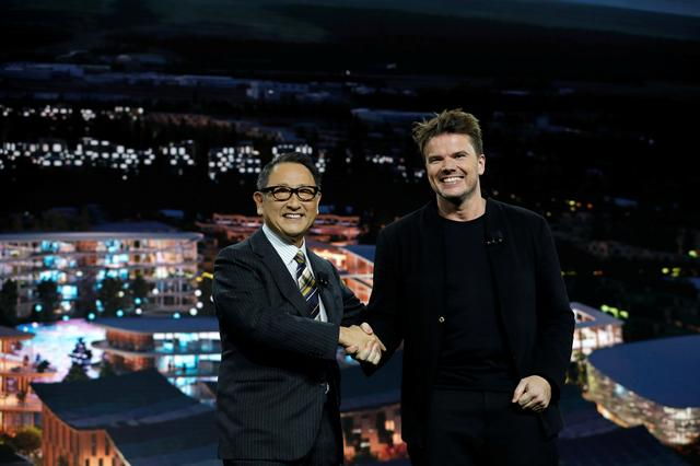 Akio Toyoda (L), president of Toyota Motor Corporation, and Danish architect Bjarke Ingels, CEO of Bjarke Ingels Group, pose at a news conference where Toyota announced plans to build a prototype city of the future on a 175-acre site at the base of Mt. Fuji in Japan, during the 2020 CES in Las Vegas, Nevada, U.S. January 6, 2020. REUTERS/Steve Marcus