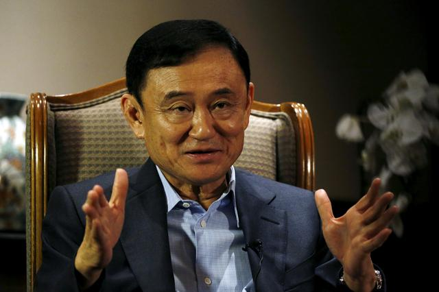 FILE PHOTO: FILE PHOTO: Former Thai Prime Minister Thaksin Shinawatra speaks to Reuters during an interview in Singapore February 23, 2016.  REUTERS/Edgar Su/File Photo
