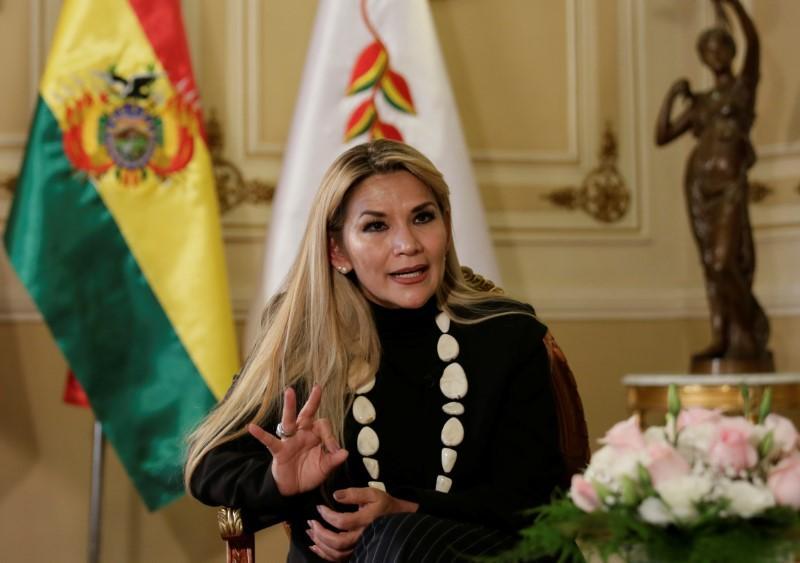 Bolivia's caretaker president seeks to unite opposition to Morales...