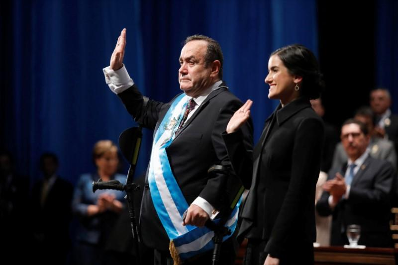 Guatemalan president takes office amid political jostling and delays