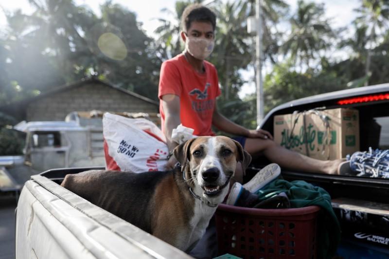 Philippine residents retrieve animals, belongings amid threat of...