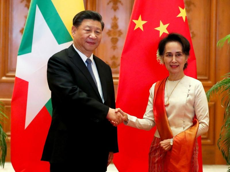 Myanmar, China ink deals to accelerate Belt and Road as Xi courts an isolated Suu Kyi