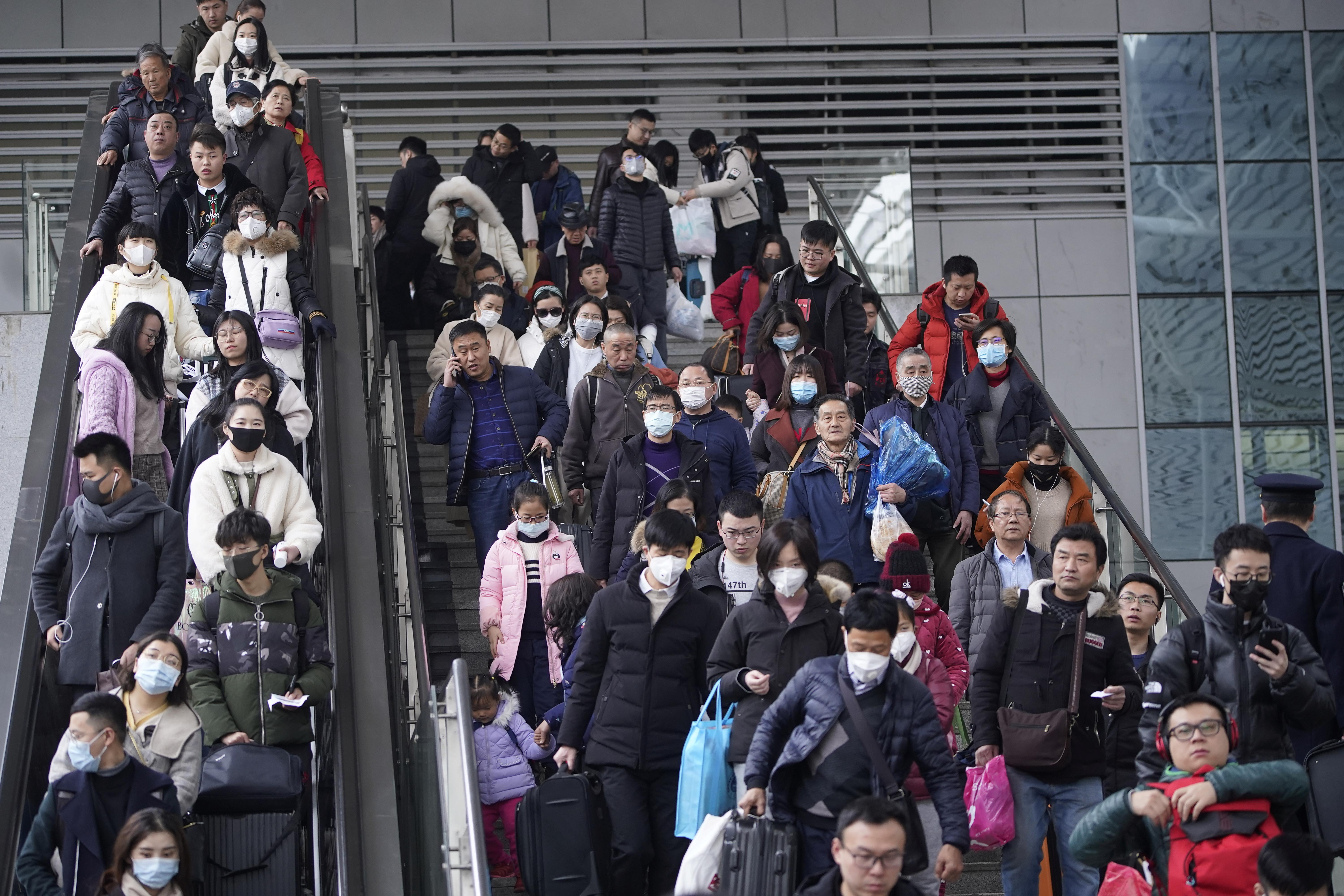 China virus spreads to U.S., curbing travel plans and spooking markets