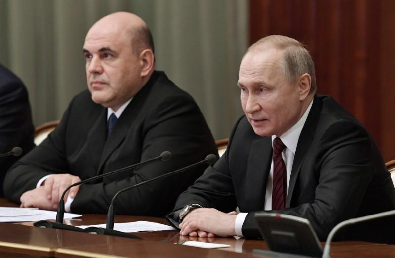 Putin hoping to secure economic legacy with reshuffle: sources