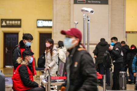 Residents of China's Wuhan rush to stock up as transport links severed