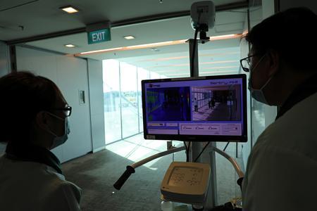 Singapore ramps up virus fight, reviving memories of SARS pandemic