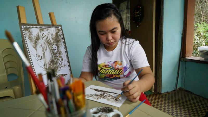 Philippine artist paints images of volcanic devastation using ash