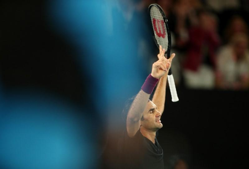 Federer finds 'super breaker' to his liking after escaping defeat