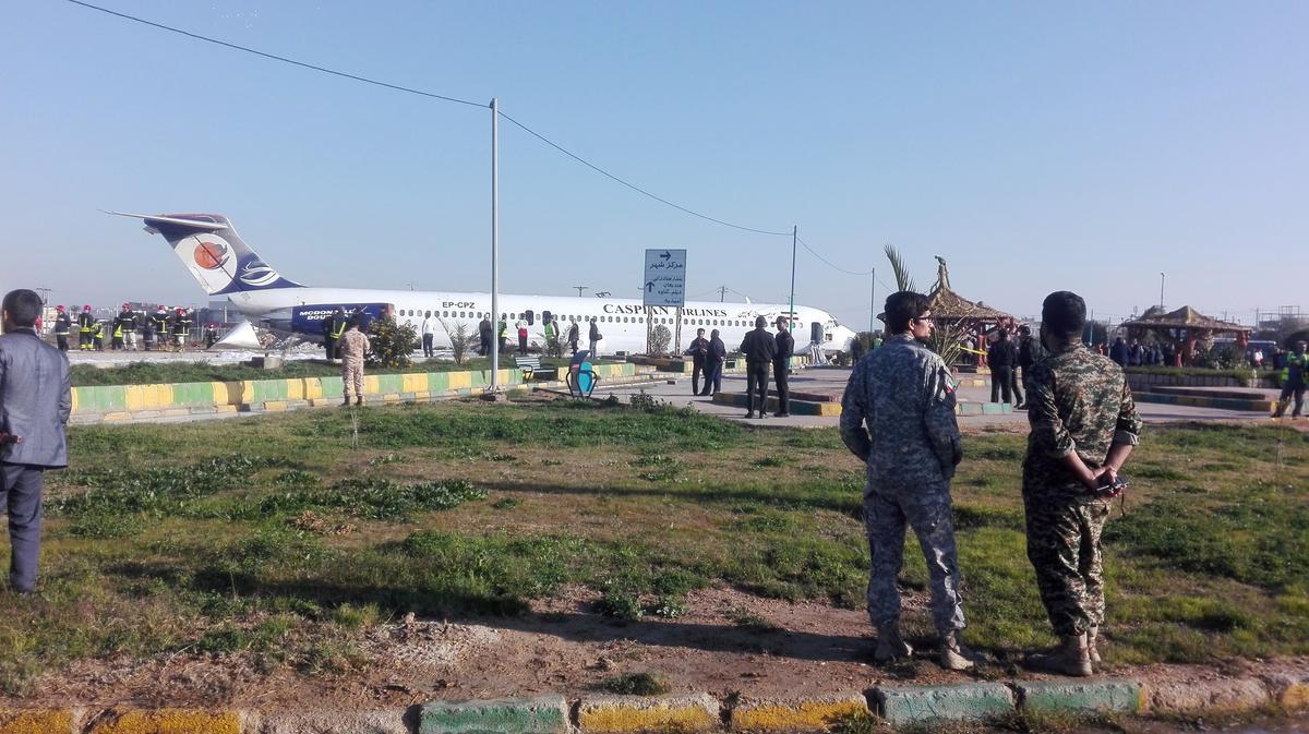 Iranian passenger plane slides off runway into highway, passengers...