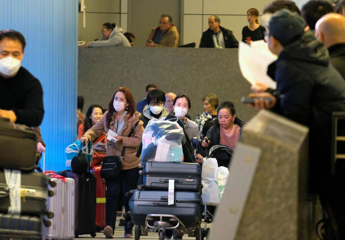 China encourages people to reconsider timing of overseas travel to curb virus spread
