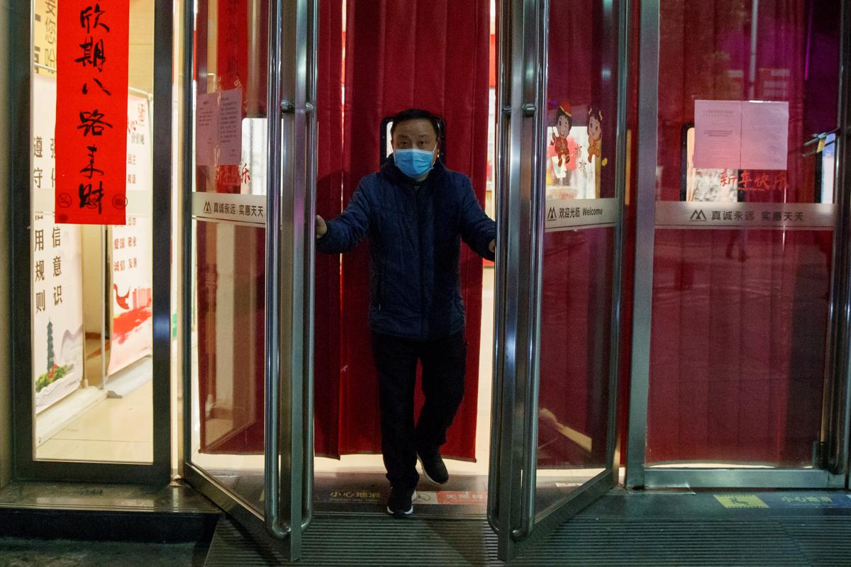 First coronavirus death outside China reported as infections top 14,000