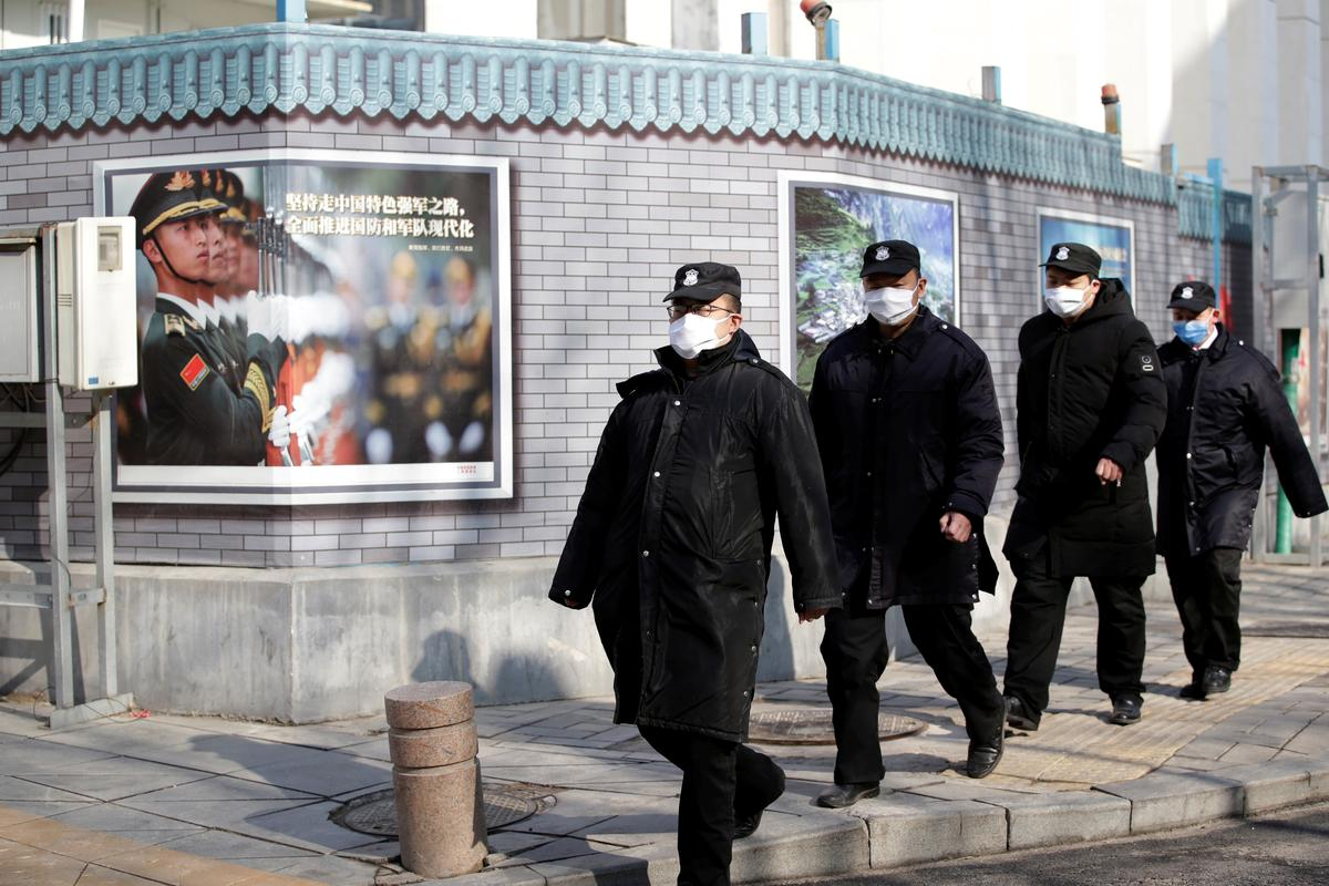 China counts economic cost of virus as markets plunge, death toll up
