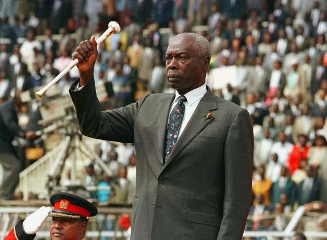 President Daniel Arap Moi raises his baton to salute Kenyans during the 34th independence day celebrations in Nairobi, Kenya December 12, 1997. REUTERS/George Mulala