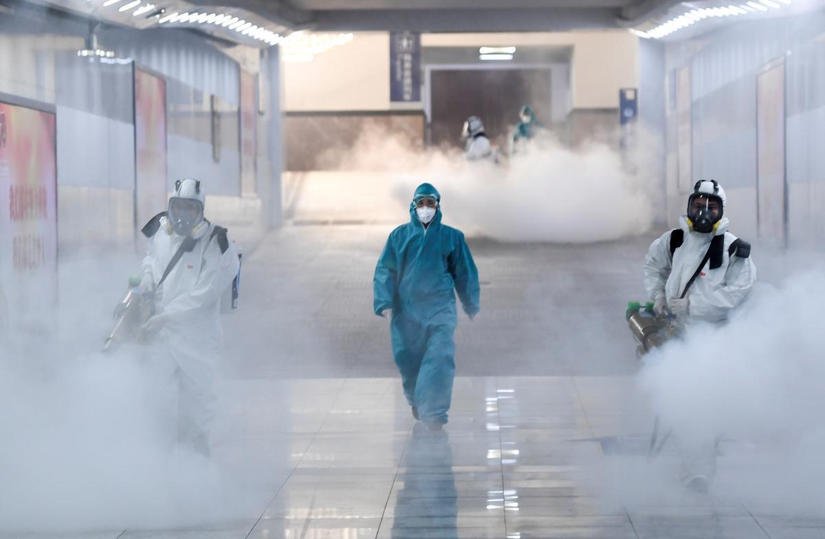 Hong Kong sees first virus death, markets enjoy breather