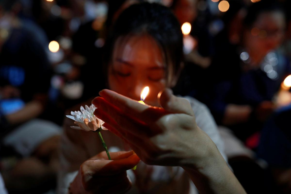 Thousands light candles for victims of Thailand mass shooting