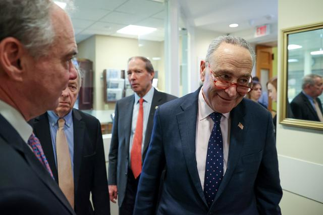 U.S. Senate Minority Leader Chuck Schumer (D-NY), with Senator Tim Kaine (D-VA), Sen. Dick Durbin (D-IL) and Sen. Tom Udall (D-NM) arrives for a news conference after the final vote on the war powers resolution regarding potential military action against Iran, at the Capitol in Washington, U.S. February 13, 2020.  REUTERS/Jonathan Ernst