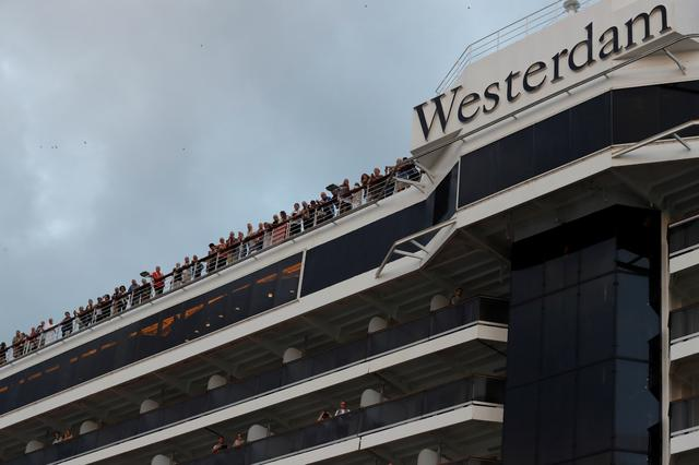 MS Westerdam, a cruise ship that spent two weeks at sea after being turned away by five countries over fears that someone aboard might have the coronavirus is seen in Sihanoukville, Cambodia February 14, 2020.  REUTERS/Soe Zeya Tun