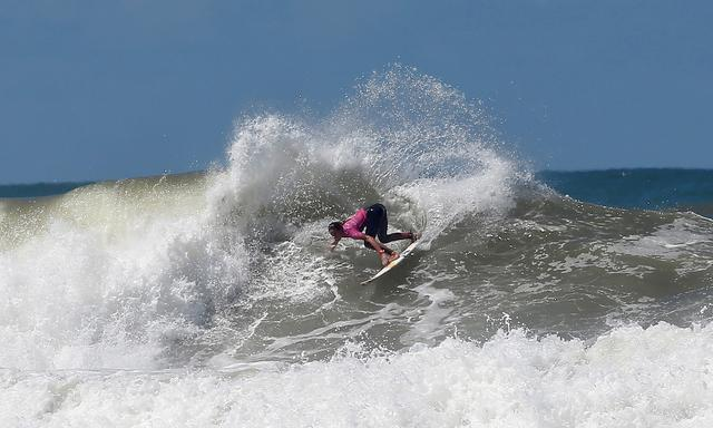 FILE PHOTO: French surfer Justine Dupont rides her wave at Casablanca Beach during the Quiksilver and Roxy Pro Casablanca surfing competition organised by the World Surf League (WSL) in Casablanca in Morocco, September 15, 2016. REUTERS/Youssef Boudlal/File Photo